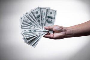 holding cash money