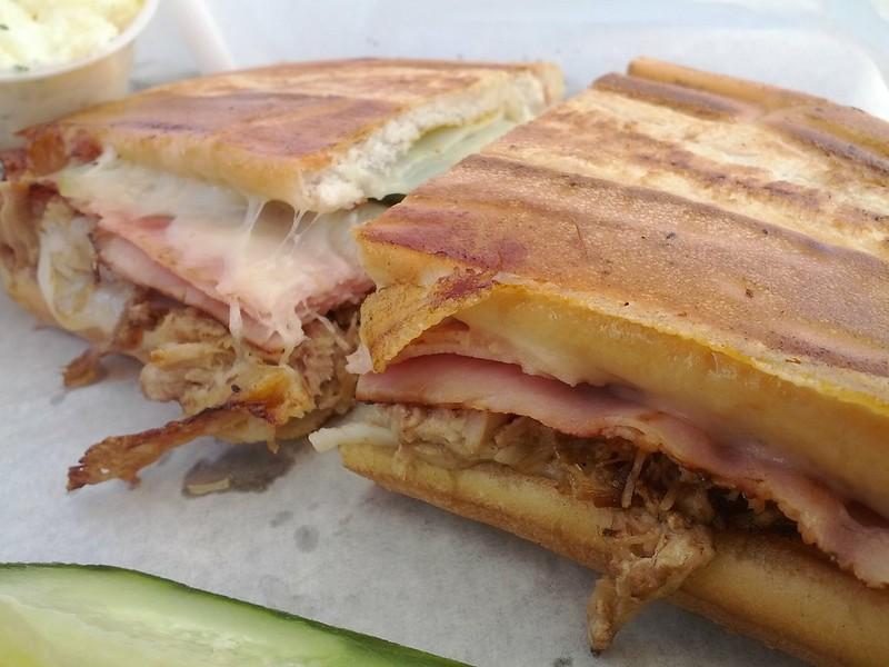 Cuban sandwich on a plate with pickle