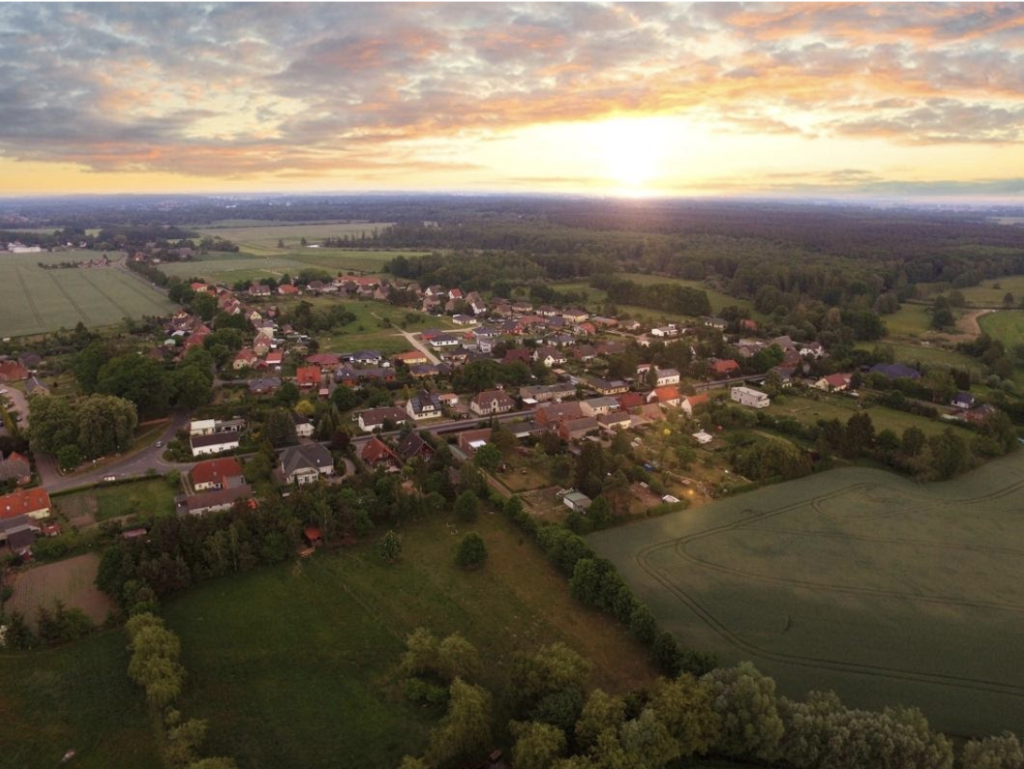 ariel shot of rural town at sundown