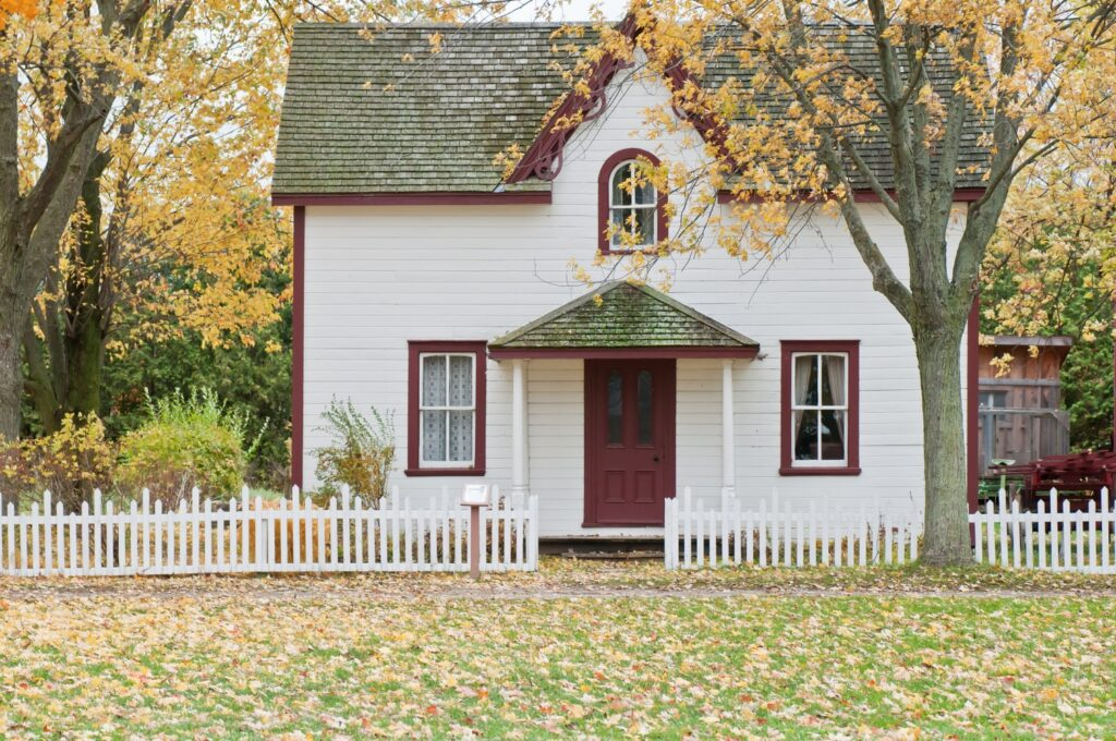 Small Home with Red Door and White PIcket Fence