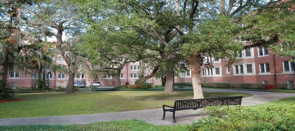 Housing complex with a bench and trees