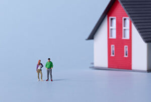 A model home with human figurines
