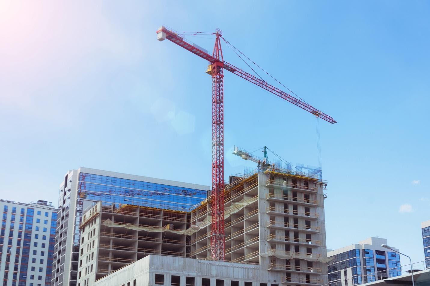 Crane constructing a commercial building