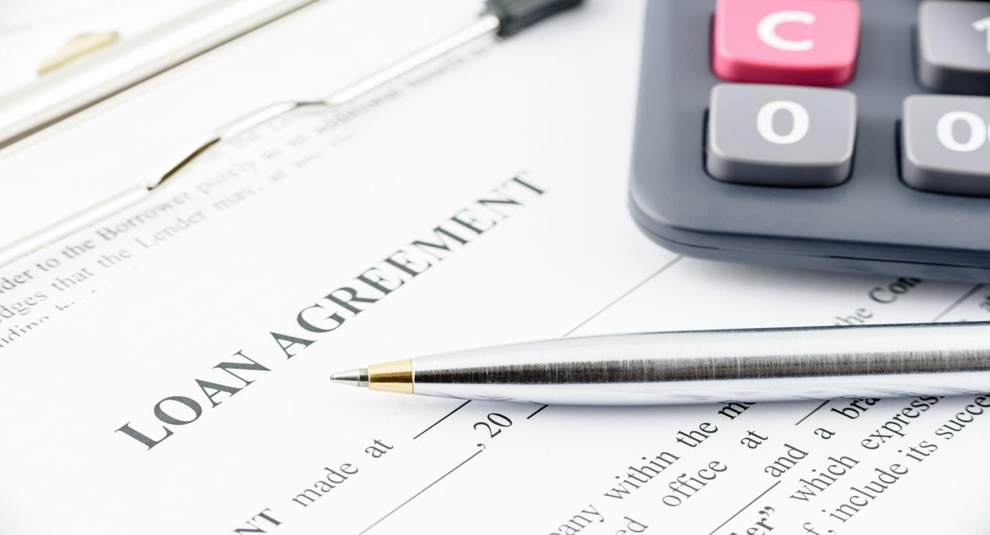 Loan agreement signing papers
