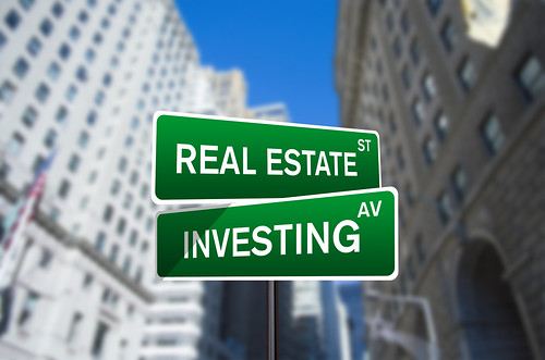 real estate investing street sign